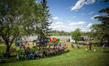 community gathering on the riverbank