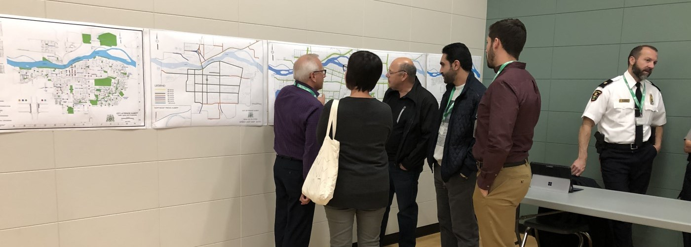 Community members view a map on display