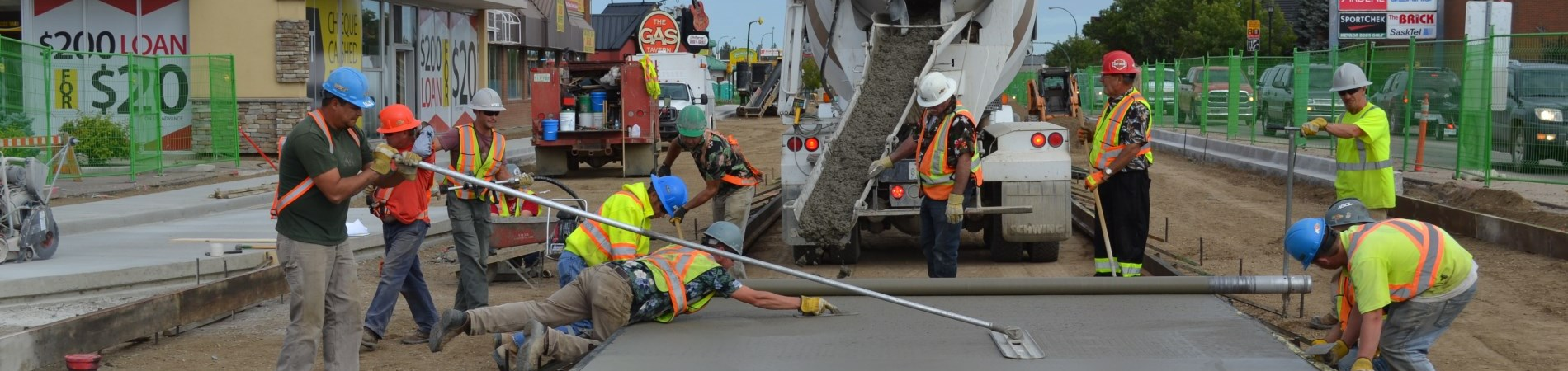 Crews laying cement on 2nd Avenue West