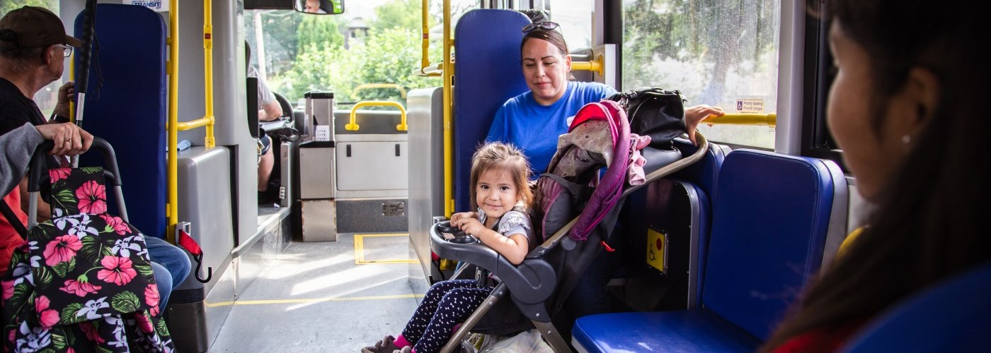 girl in a stroller on bus
