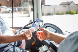 bus driver accepting a fare