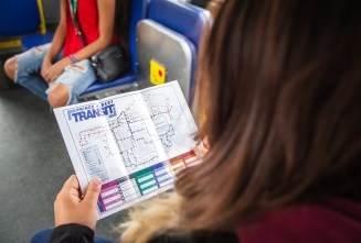 a woman viewing a printed map on a bus