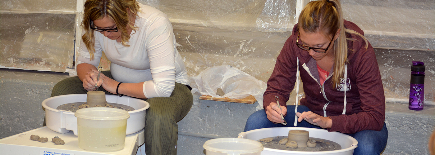 2 ladies in pottery class