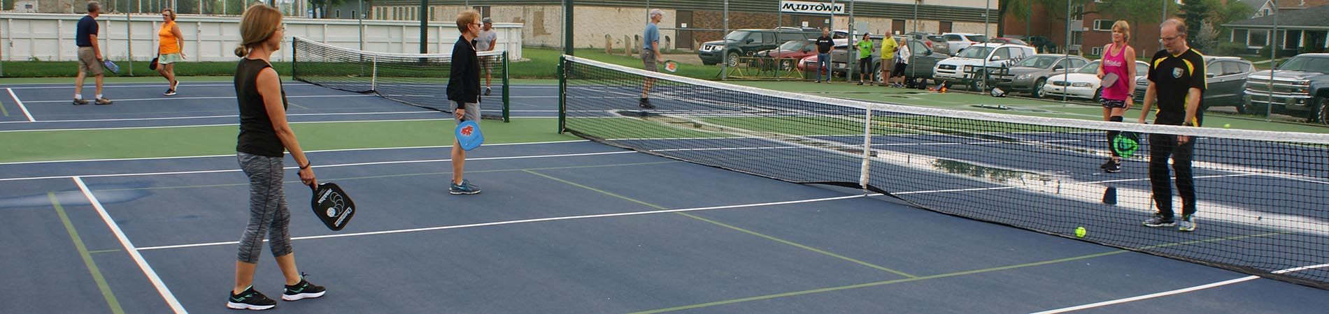 Seniors playing pickleball at Midtown