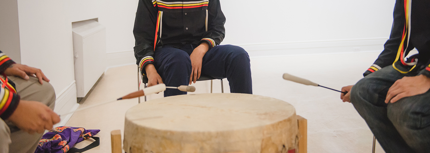 youth playing drum at Creative Days