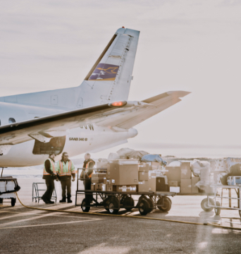 People packing cargo into a plane