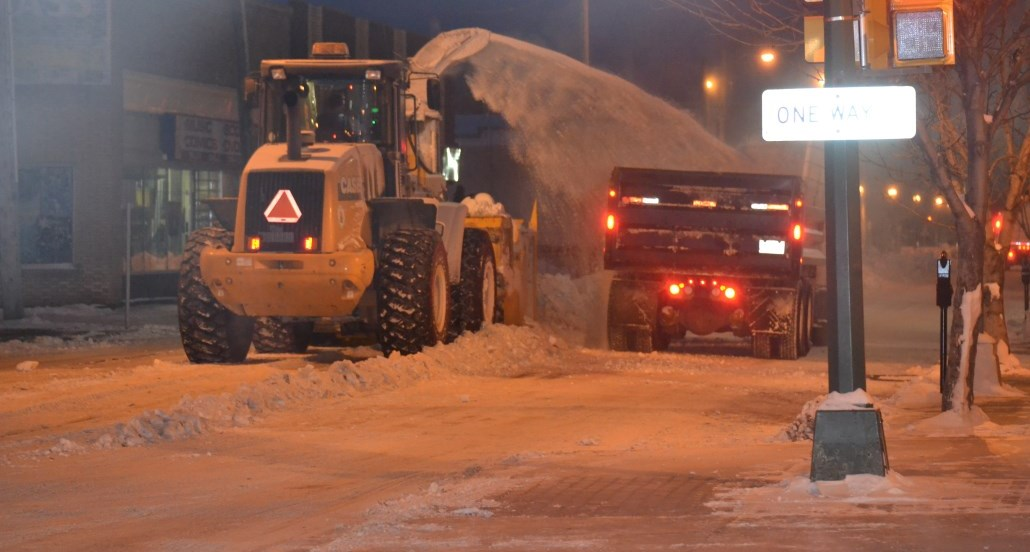 crews lifting snow downtown